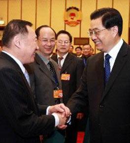 <strong><center>胡锦涛等领导同志分别参加审议和讨论</center></strong>