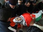 巴勒斯坦民众为死难者举行葬礼